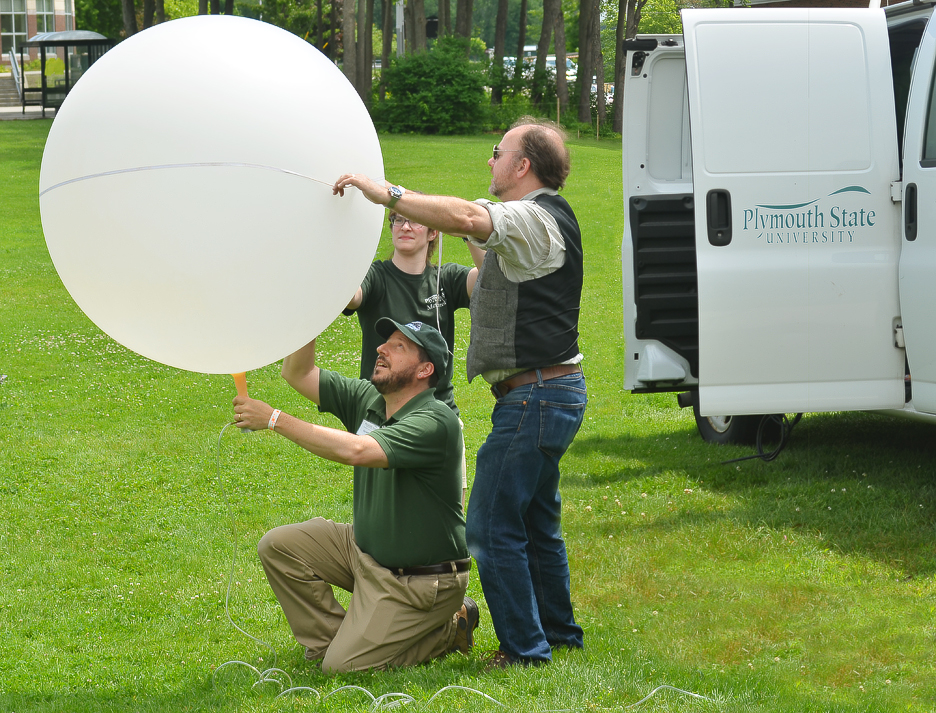 Plymouth State University faculty and volunteers prepare to launch a weather balloon at AerospaceFest in 2013