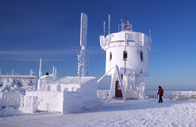 Mount Washington Observatory's extensive weather station, covered in ice and snow