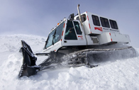 Snowcat used by MWO staff during the winter months, shown atop a tall snow drift